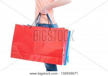 Side View Of Woman Carrying Big Shopping Bags