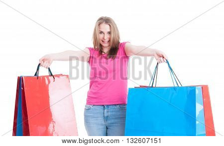 Happy Young Woman Carrying Blue And Red Shopping Bags