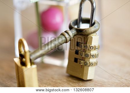 modern combination padlock with normal padlock and old key