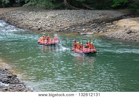 Kiulu Sabah Malaysia-October 22,2011:Group of adventurer enjoying water rafting activity at Kiulu river Sabah Borneo on October 22, 2011.The river is popular for its scenic tropical nature view.