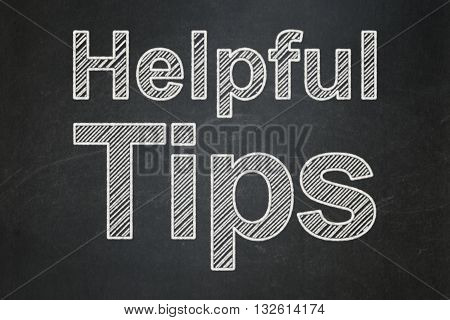 Learning concept: text Helpful Tips on Black chalkboard background