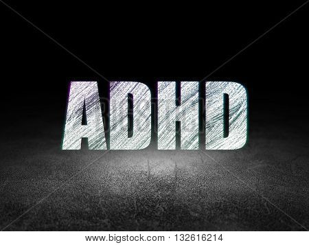 Healthcare concept: Glowing text ADHD in grunge dark room with Dirty Floor, black background