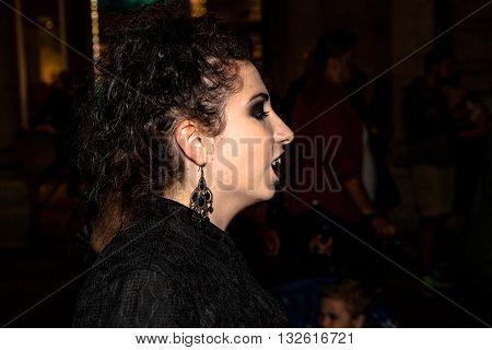 Bologna, Italy - May 21, 2016: Bologna zombie apocalypse walk: profile of female vampire showing his fangs.