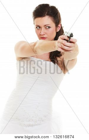 Wedding Day. Angry betrayed bride concept. Woman in white dress with gun isolated on white. Studio shot.
