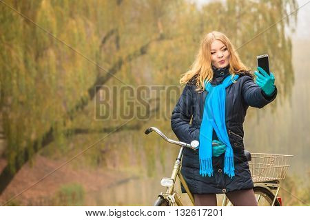 Happy Woman With Bike In Park Taking Selfie Photo.