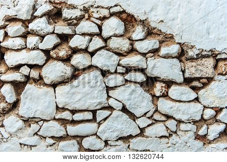 Stone wall background, close up whitewashed stones