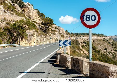 80 km/h speed limit sign on a mountain highway. Spain