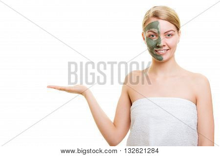Woman In Clay Mud Mask On Face Holds Open Palm