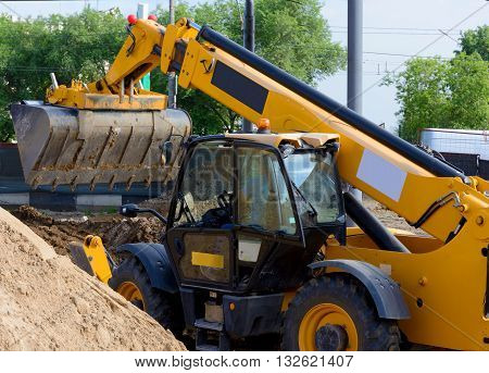 wheel loader excavator in a road construction