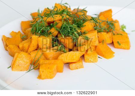Fried batatas or sweet potatoes with herbs