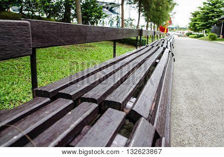 Empty brown bench in the garden park