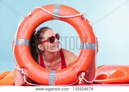 Happy woman girl in heart shape sunglasses with ring buoy lifebuoy.