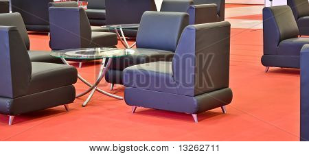black armchairs on the red floor