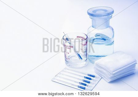 Needles for acupuncture isolated on blue background
