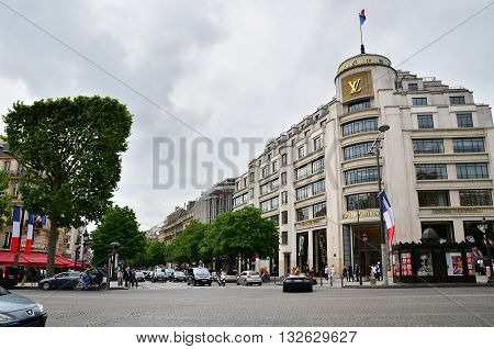 Paris France - May 14 2015: Tourists Shopping at Louis Vuitton store on May 14 2015 in Paris France. This store is located on the Champs Elyses and offers a wide range of luxury Louis Vuitton clothes and accessories