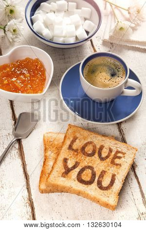 Breakfast, coffee, jam and toast with the text love you
