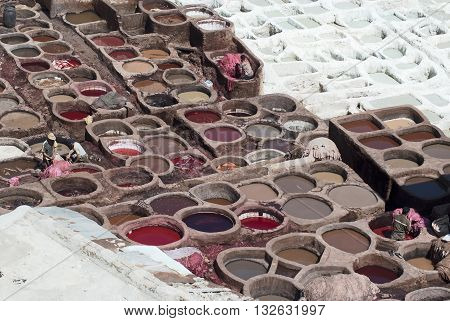 Workers Processing Hides In Colorful Tanning Pools At A Traditional Leather Tannery, Fes , Morocco,