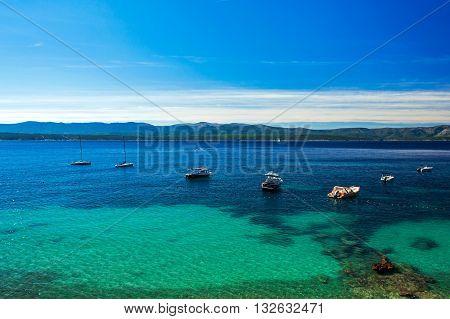 beautiful sea view on crystal turquoisel water bay with yachts and boats on island Brac Croatia
