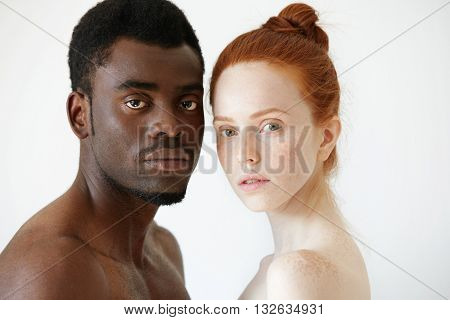 Close Up Portrait Of Black Man And White Woman Standing Isolated Against White Studio Wall Backgroun