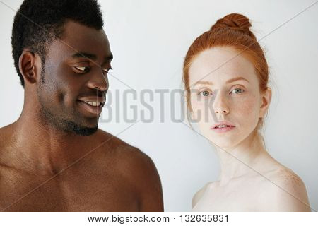Portrait Of Happy Loving Interracial Couple: Shirtless African Man Looking At His Nude Redhead Cauca