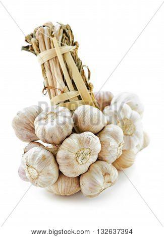 Bundle of garlic isolated on white background