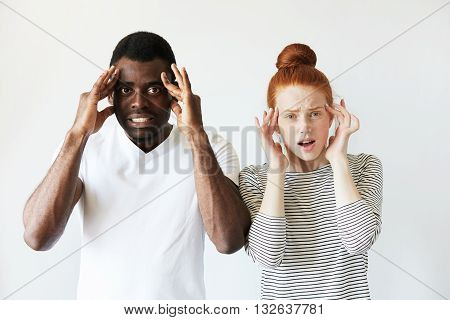 Portrait Of Irritated And Annoyed Young Mixed-race Couple. African Man And Caucasian Woman Looking A