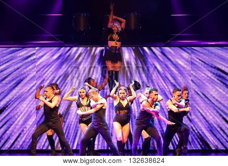NEW YORK-JUL 9: Julianne Hough (top) and Derek Hough (C) perform on stage during the Move Live On Tour at Radio City Music Hall on July 9, 2015 in New York City.