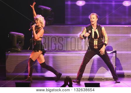 NEW YORK-JUL 9: Derek Hough (R) and Julianne Hough (top) perform on stage during the Move Live On Tour at Radio City Music Hall on July 9, 2015 in New York City.