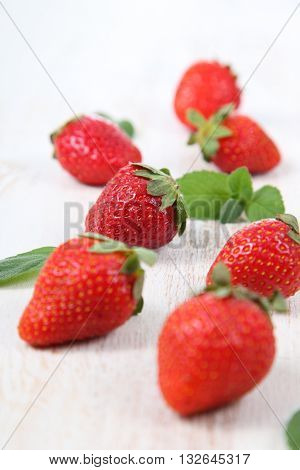 Ripe Strawberries And Mint On A  Table
