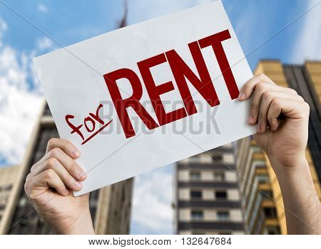 For Rent placard with urban background