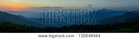 Panorama. Sunrise scene in Carpathian Mountains. The largest mountains of Ukraine - Goverla and Petros in background.