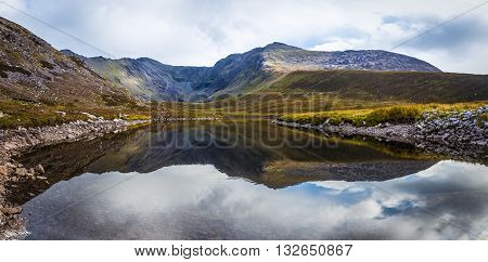 Reflection Of The Macgillycuddy's Reeks In Lough Eagher