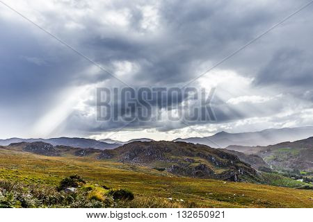 Rock Formation Landscape With Clouds And Sun Rays In Ireland