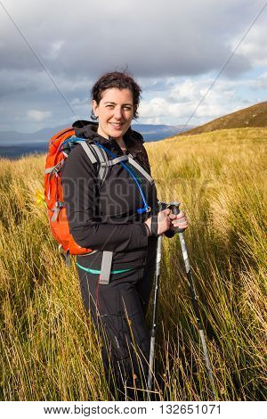 Female Hiker Posing At The Foot Of Carrauntoohil