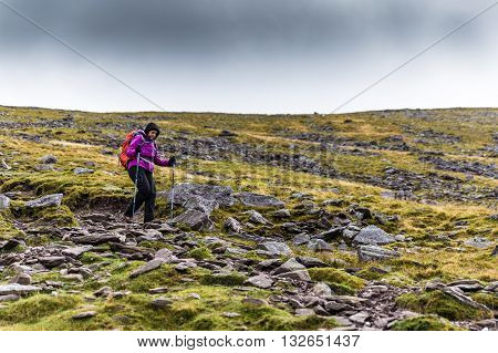 Femal Hiker Hiking Downhill From A Mountain