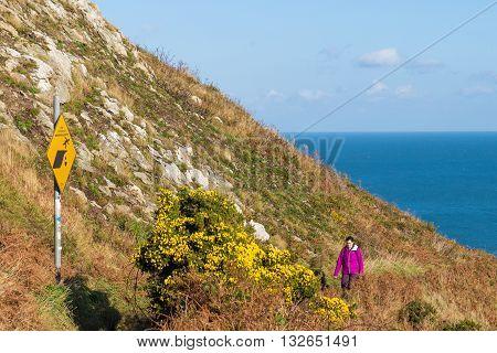 Female Tourist Hiking Along Dangerous Cliffs