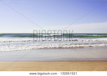 Waves Rolling Gently on to the Deserted Sea Shore