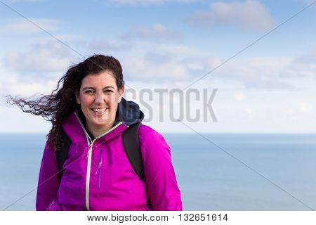 Young Woman Posing With Her Hair Waving The Wind
