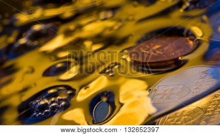 water to bubble, money in water, the gold river, coins of the different countries, indistinct