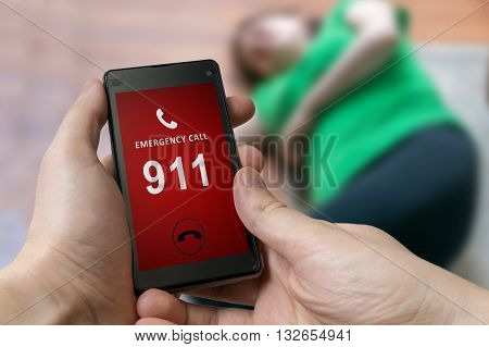 Man Dialing Emergency (911 Number) On Smartphone. Injured Woman