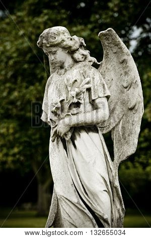 Old cemetery angel sculpture made of stone. London graveyard