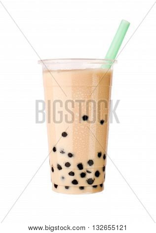 Bubble tea with milk, black tapioca balls and straw, isolated on white