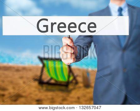 Greece - Businessman Hand Holding Sign