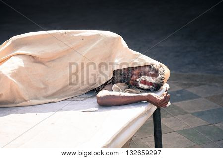 Jaipur India - 2014 December 29 : An Indian holy man sleeping inside a Hindu temple on Choti Chaupar square in the city of Jaipur also known as the Pink City in Rajasthan India