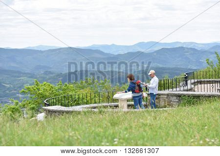 Hikers looking at orientation table from scenery point