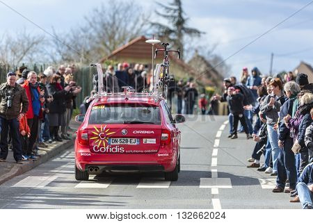 Conflans-Sainte-Honorine,France-March 6,2016: The technical car of Cofidis Team following its cyclist during the prologue stage of Paris-Nice 2016.