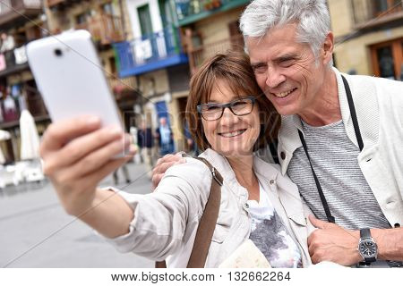 Senior couple taking selfie picture with smartphone