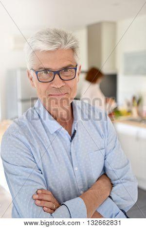 Portrait of smiling senior man with eyeglasses