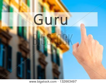 Guru - Hand Pressing A Button On Blurred Background Concept On Visual Screen.