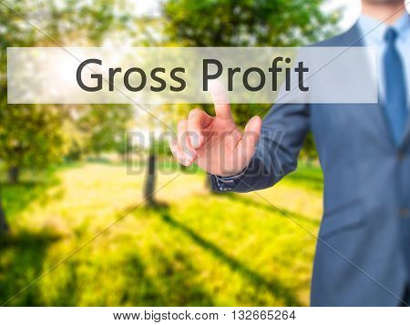 Gross Profit - Businessman Hand Pressing Button On Touch Screen Interface.